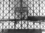"The KL Dachau entrance gate with the words ""Arbeit macht frei"" (work sets you free). (IPN)"
